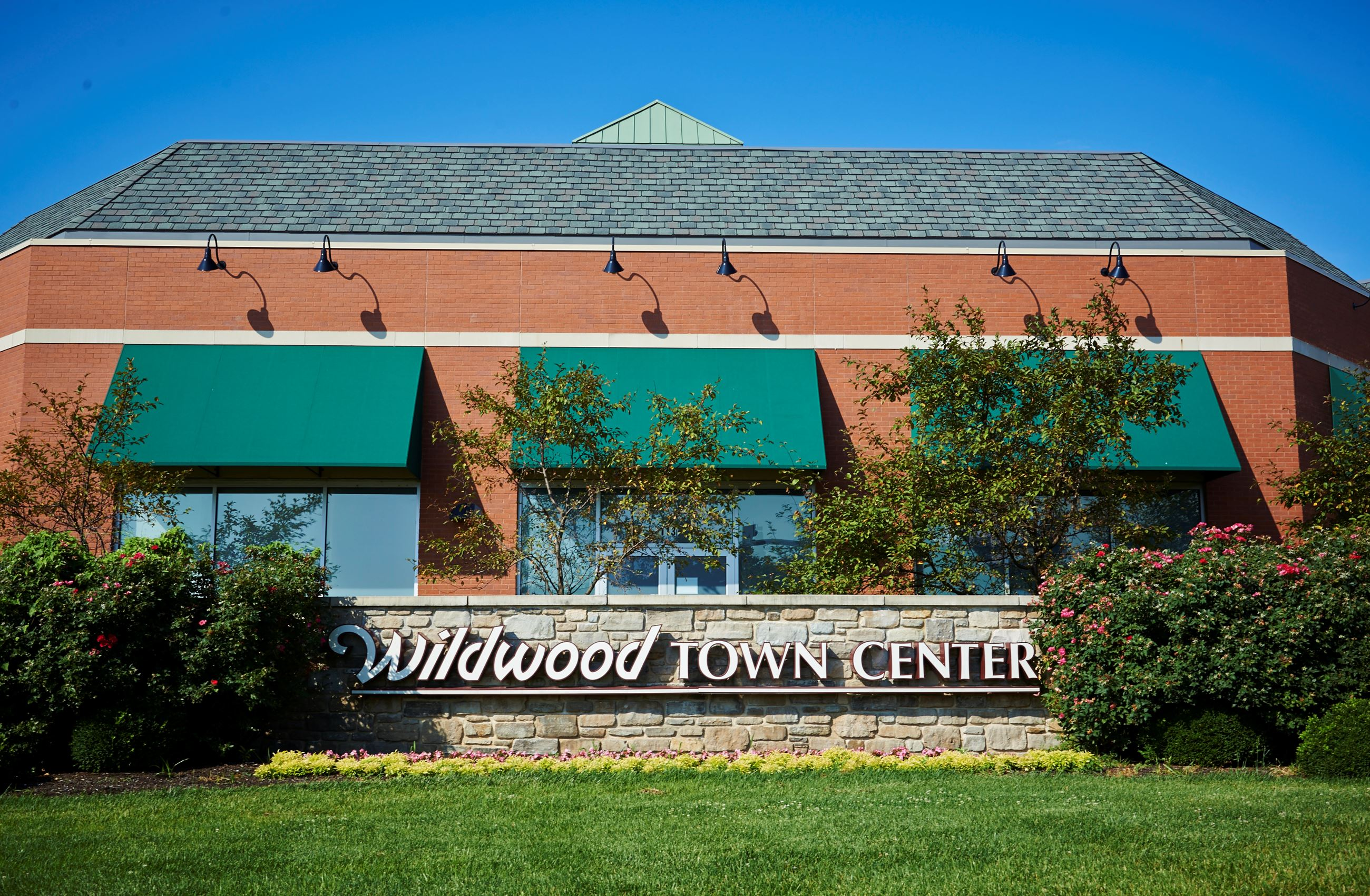 Wildwood Town Center sign in front of building