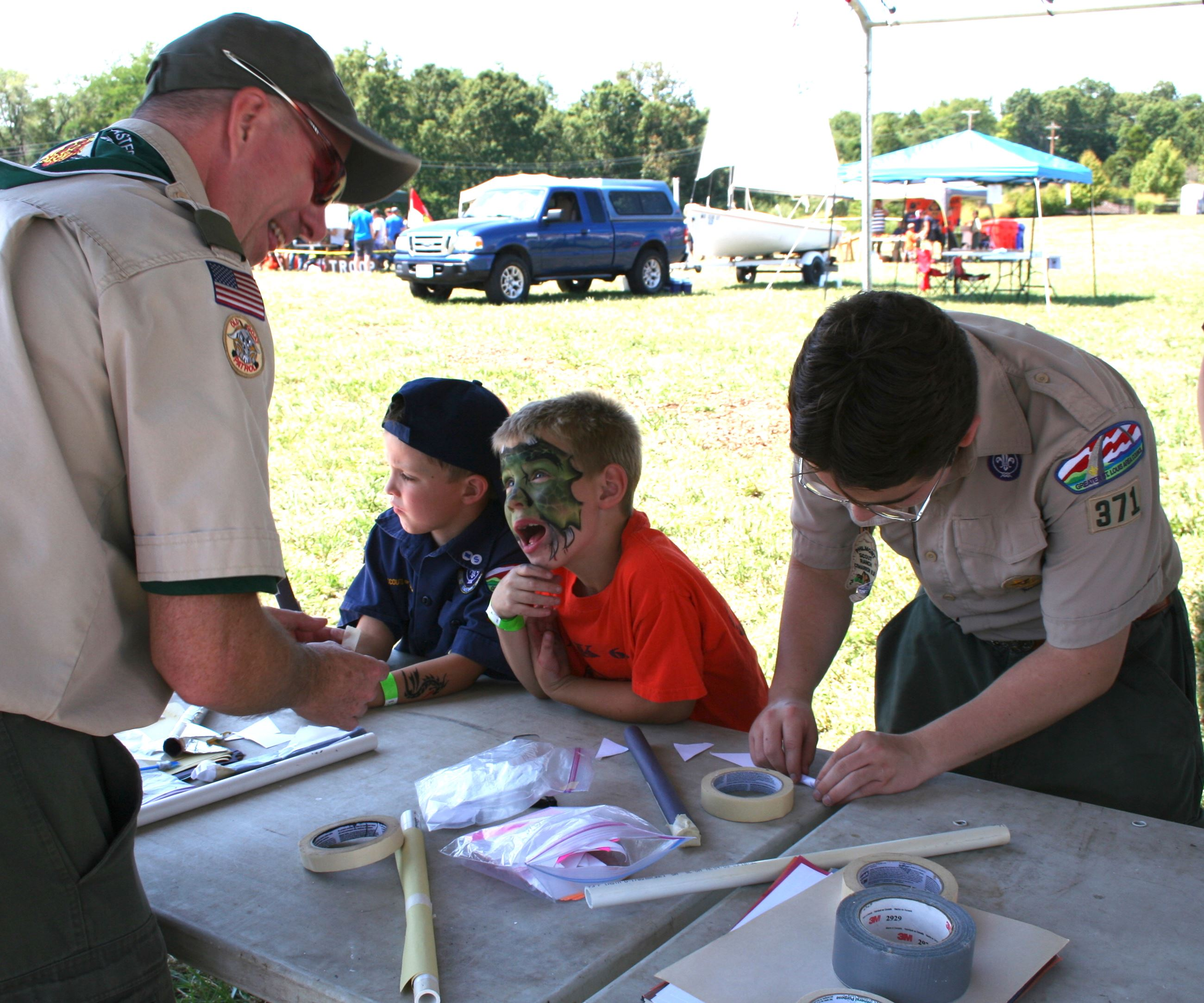 Young boys building rockets with the Boys Scouts