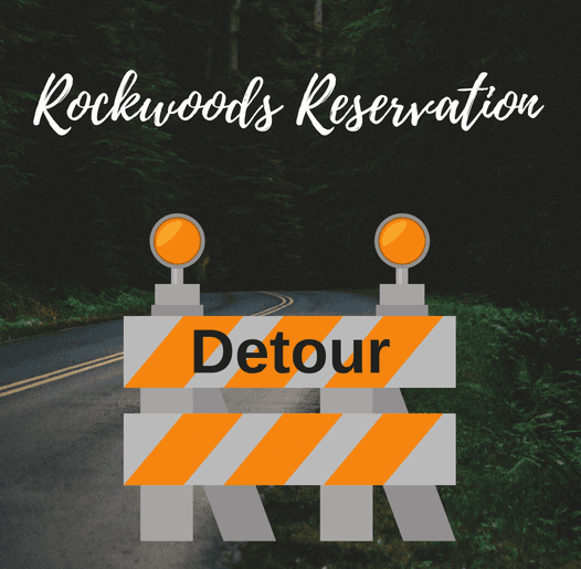 Photo of wooded road with detour sign for Rockwoods Reservation