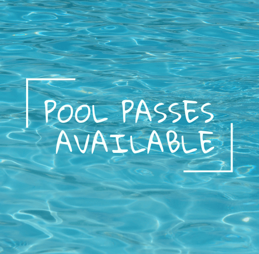 Photo of water and text saying Pool Passes Available